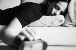 A sleepy Caucasian man turning an alarm off