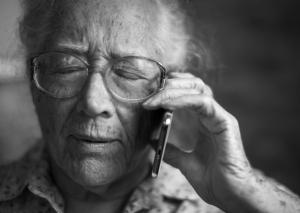 Elderly woman getting bad news